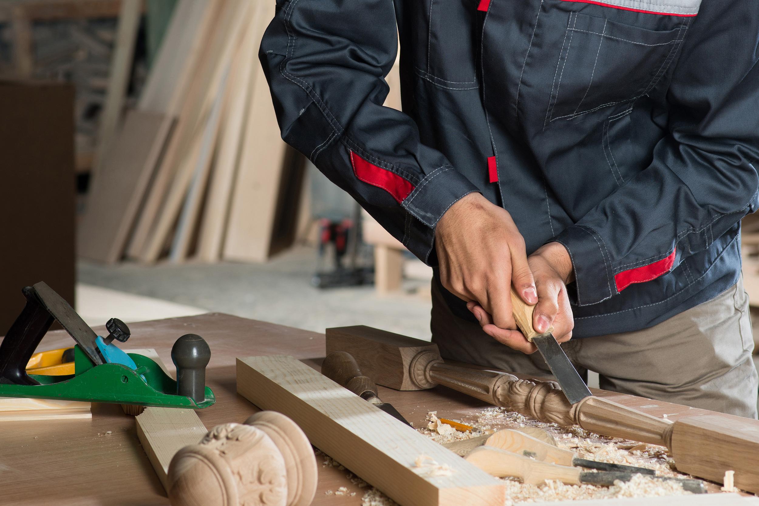 Carpenter using wood tools
